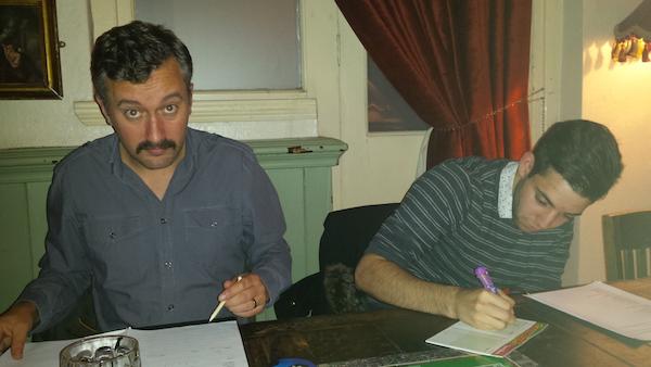 The game's administrators prepare team sheets